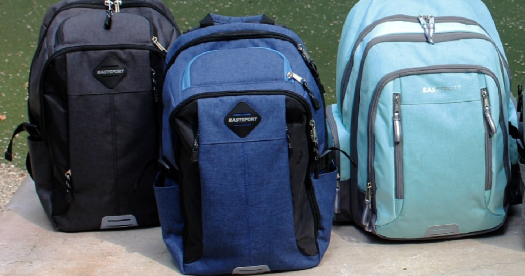 black backpack, navy backpack, and light blue backpack outside