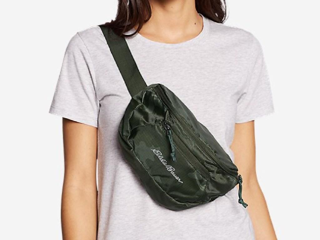woman wearing an eddie bauer packable waist fanny pack