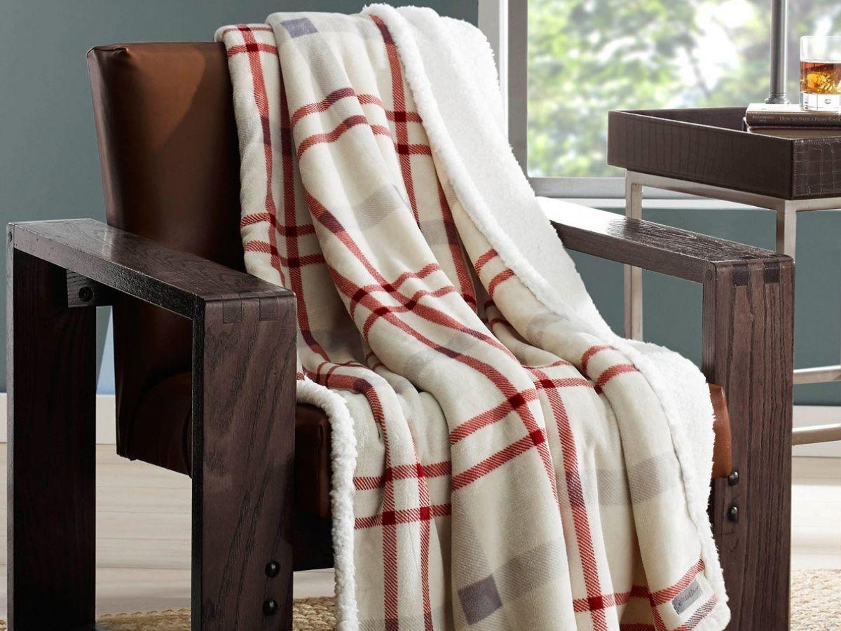 Eddie Bauer Plaid Throw draped over a wooden chair