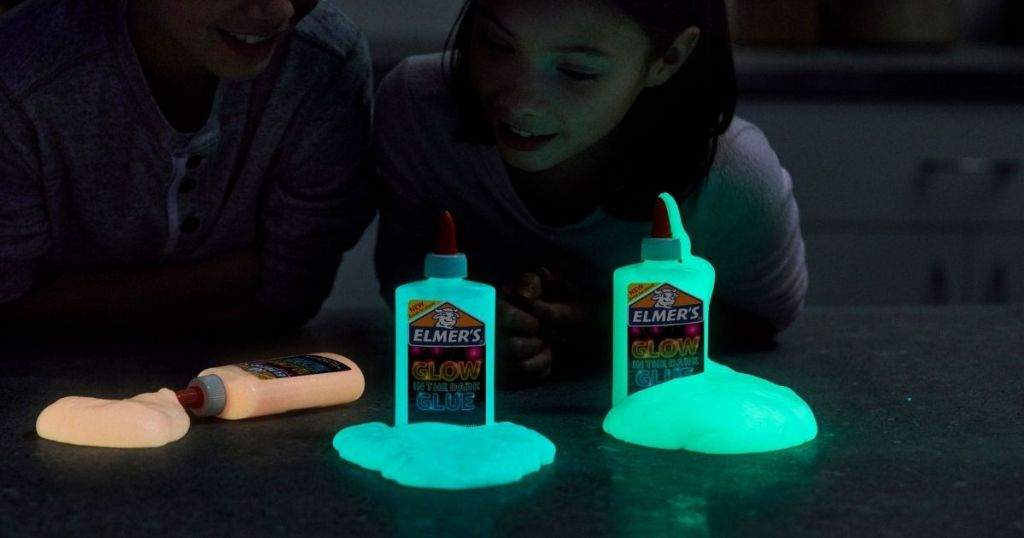 Elmer's Glow in the Dark glue bottles with glue squirting out of them