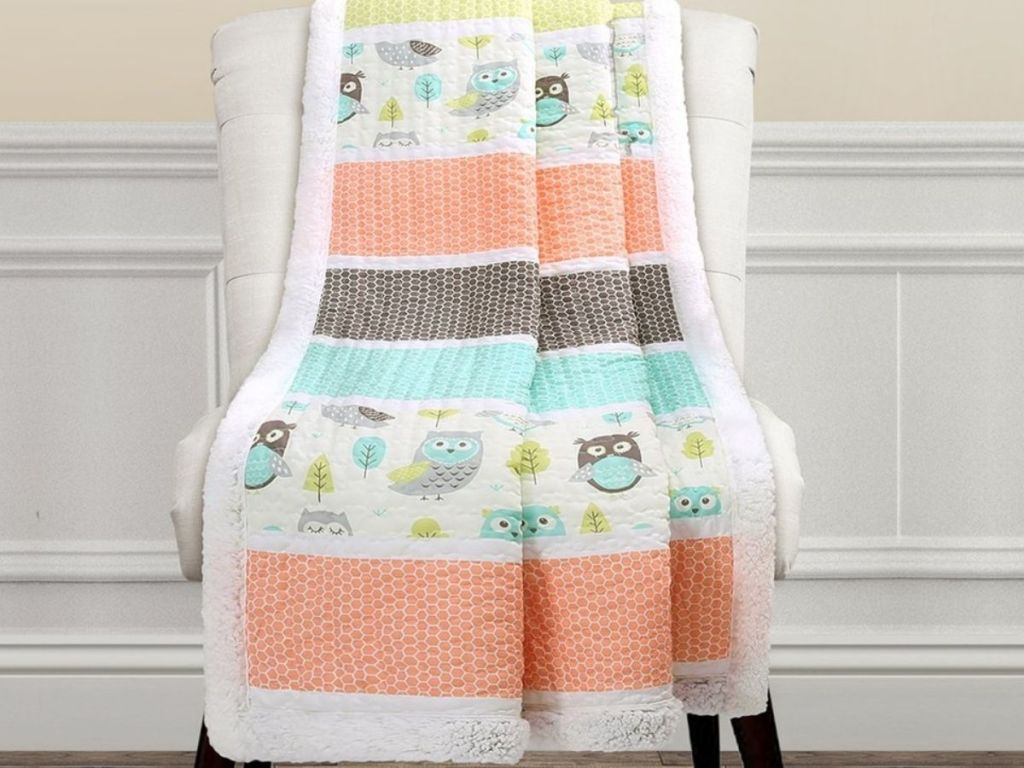 Owl Print Sherpa Lined Quilt thrown over a chair