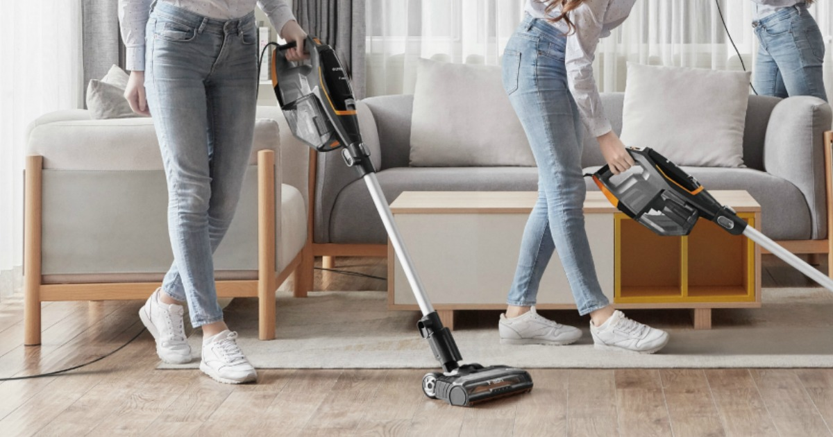 Woman vacuuming with a lightweight stick vacuum