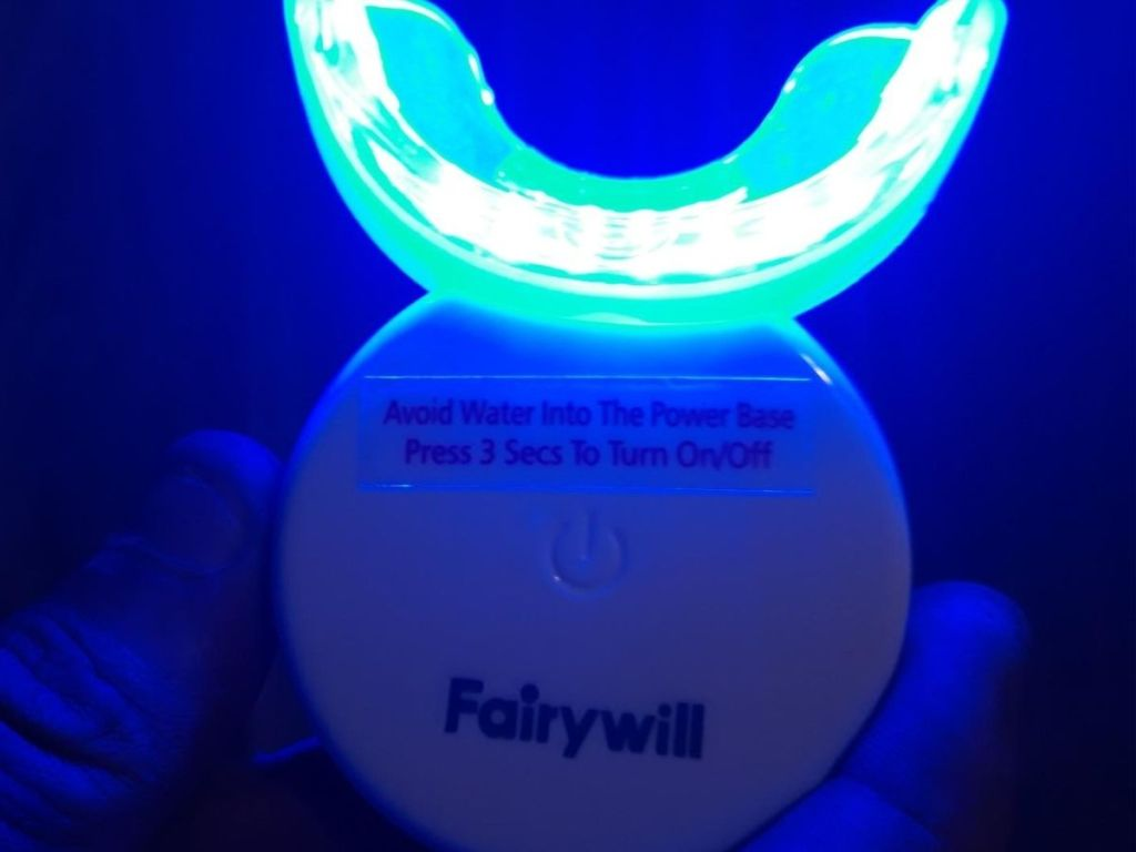 hand holding Fairywill LED whitener light