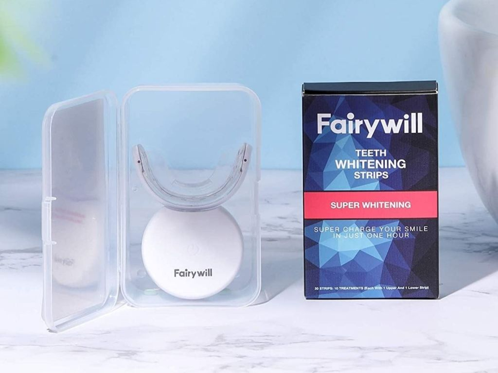 Fairywill LED Whitening light with Box of whitening strips next to it
