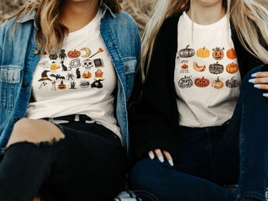 Two Girls wearing halloween and fall t-shirts
