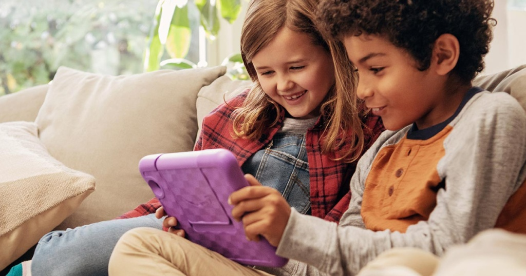"""kids on couch playing with a purple Fire HD 8 Kids Edition Tablet with 8"""" HD Display"""