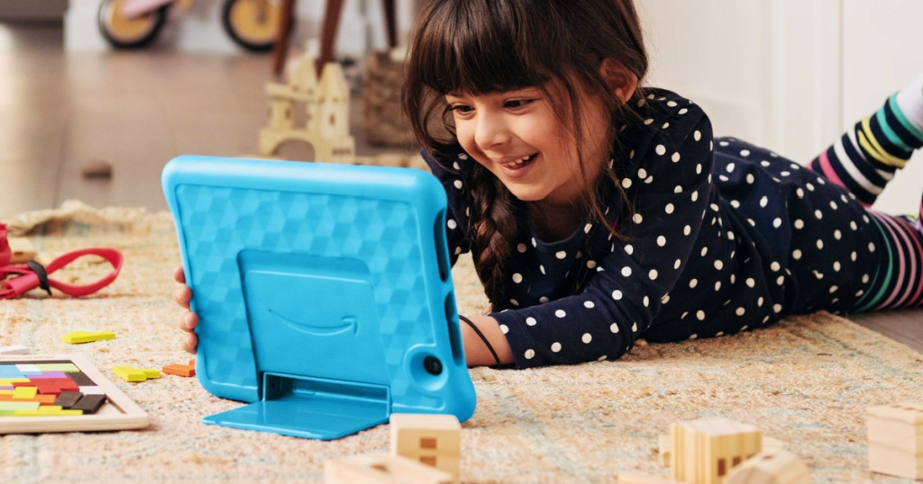 """girl playing on a blue Fire HD 8 Kids Edition Tablet with 8"""" HD Display"""