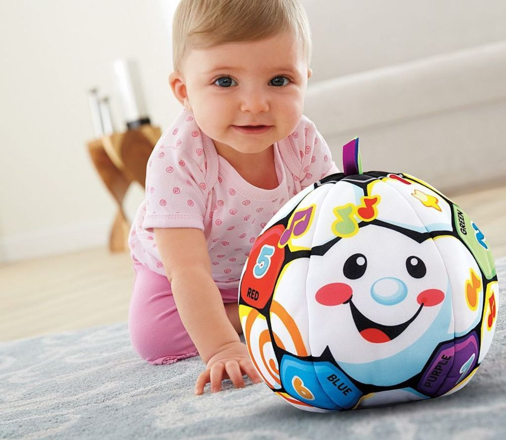 baby playing with Fisher Price Laugh and Learn Singing Soccer Ball