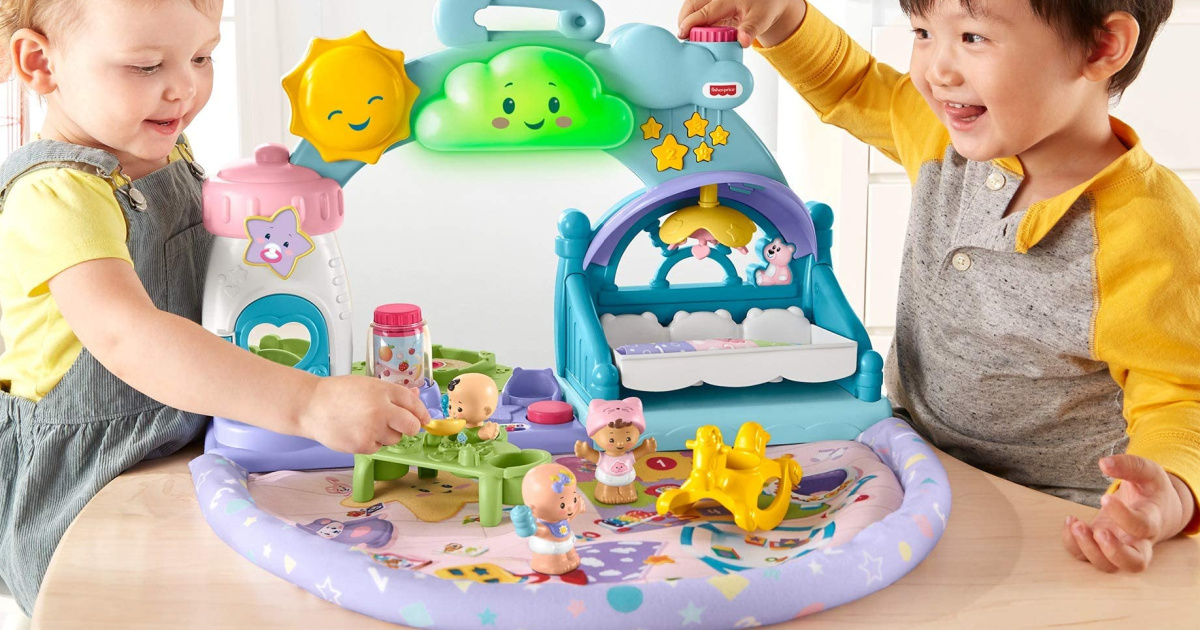 2 toddlers playing with a fisher price babies playdate playset