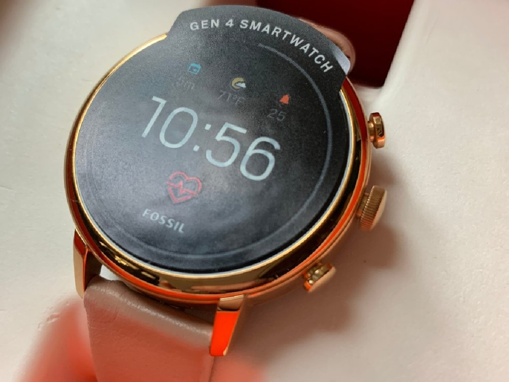 pink leather watch in case
