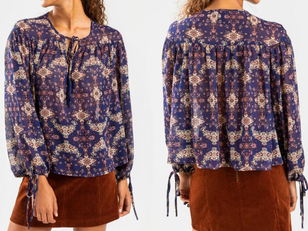 Front and back view of a women wearing a dark blue paisley blouse