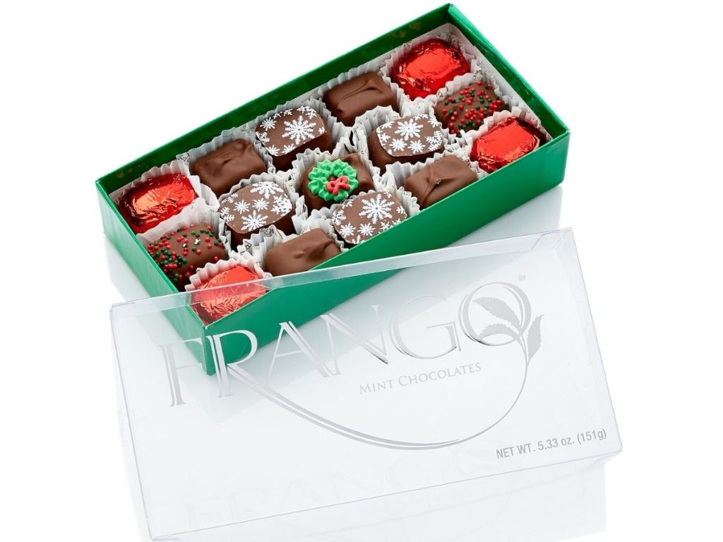 Frango Mint Chocolates with top opened revealing holiday decorated chocolates