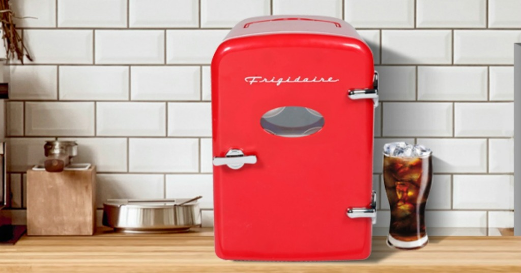 Small red fridge on a counter top