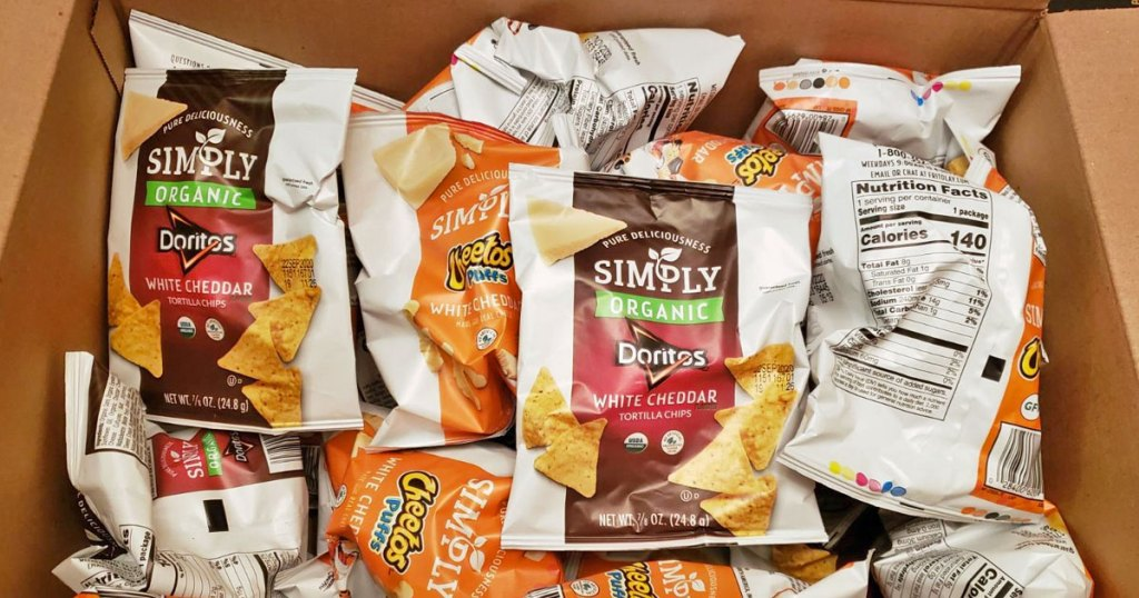 box filled with individual sized bags of simple cheetos and doritios chips