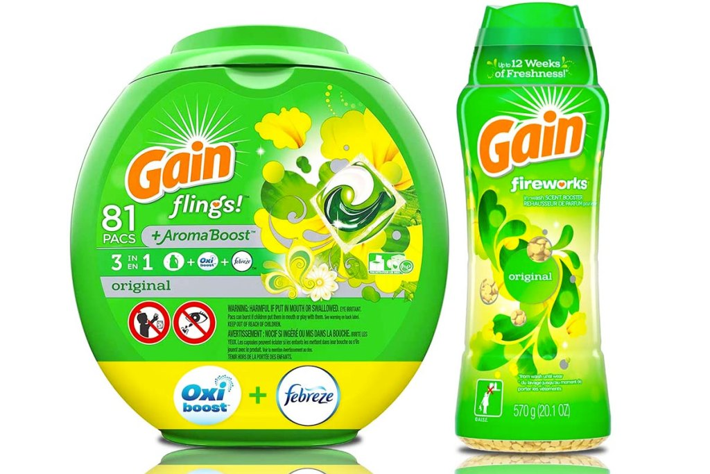 green container of gain flings laundry detergent and bottle of gain fireworks scent booster beads