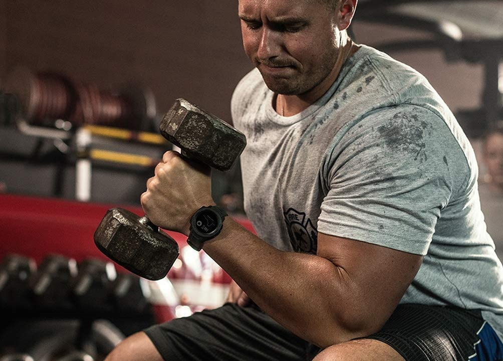 man working out with weights