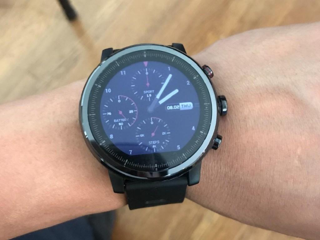 man wearing a garmin fenix 5s smartwatch
