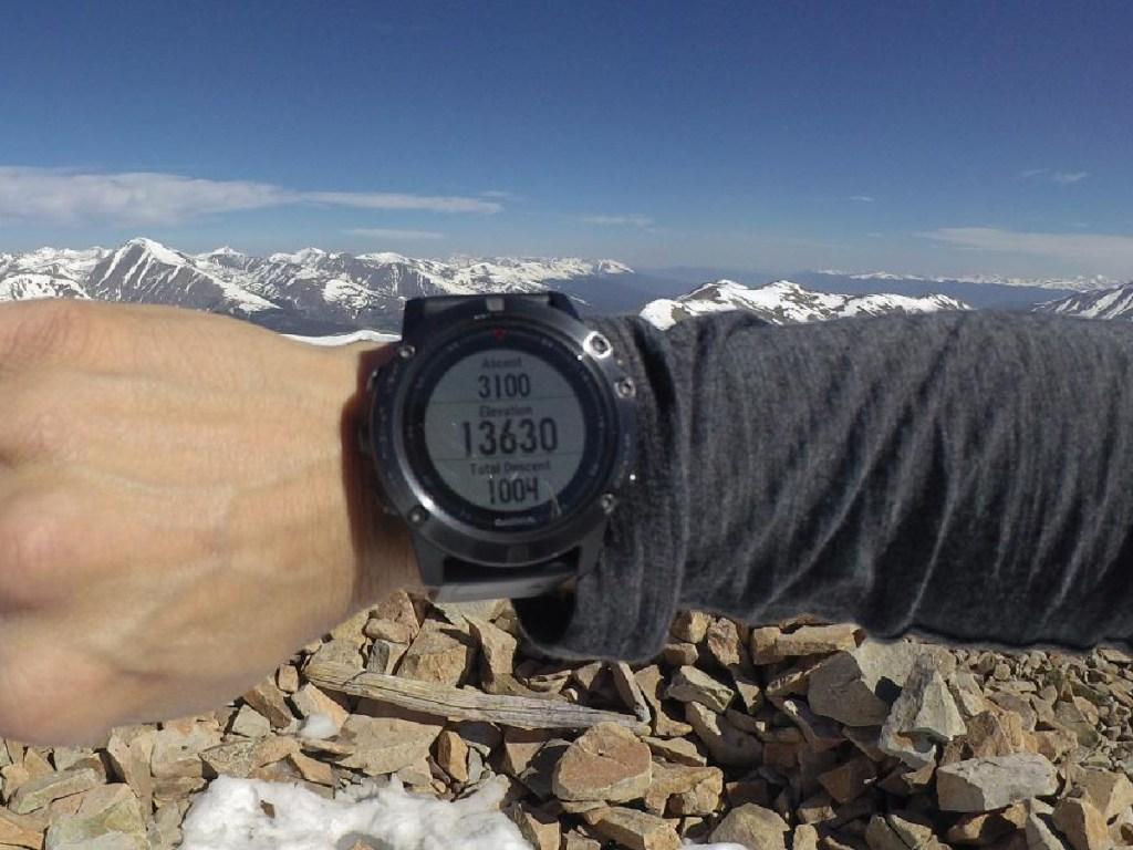 man wearing a garmin fenix 5 smartwatch