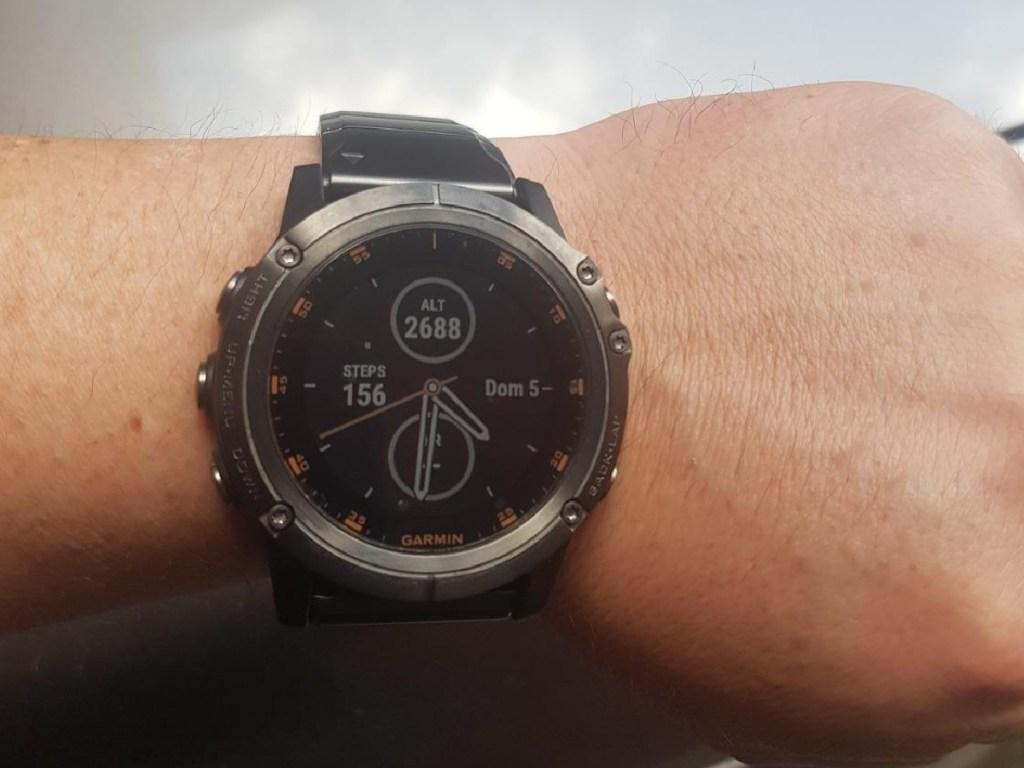 person wearing a garmin fenix 5 plus smartwatch