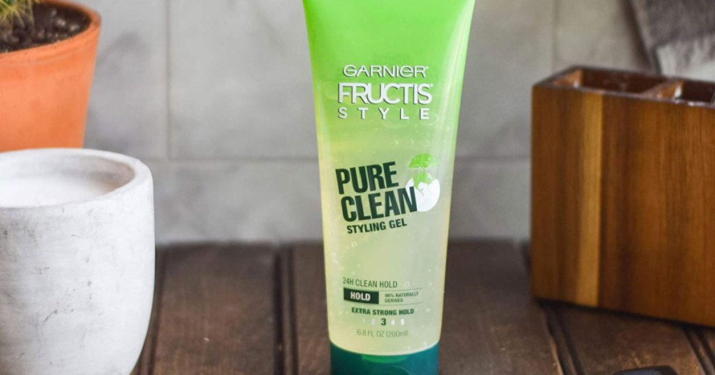 green bottle of garnier fructis hair gel