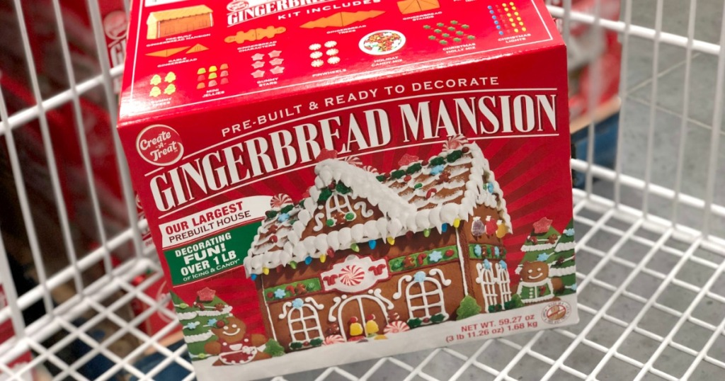 Large pre-built gingerbread mansion in package in shopping cart