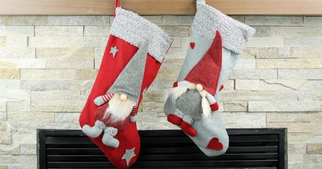 two red and grey stockings hanging on fire place