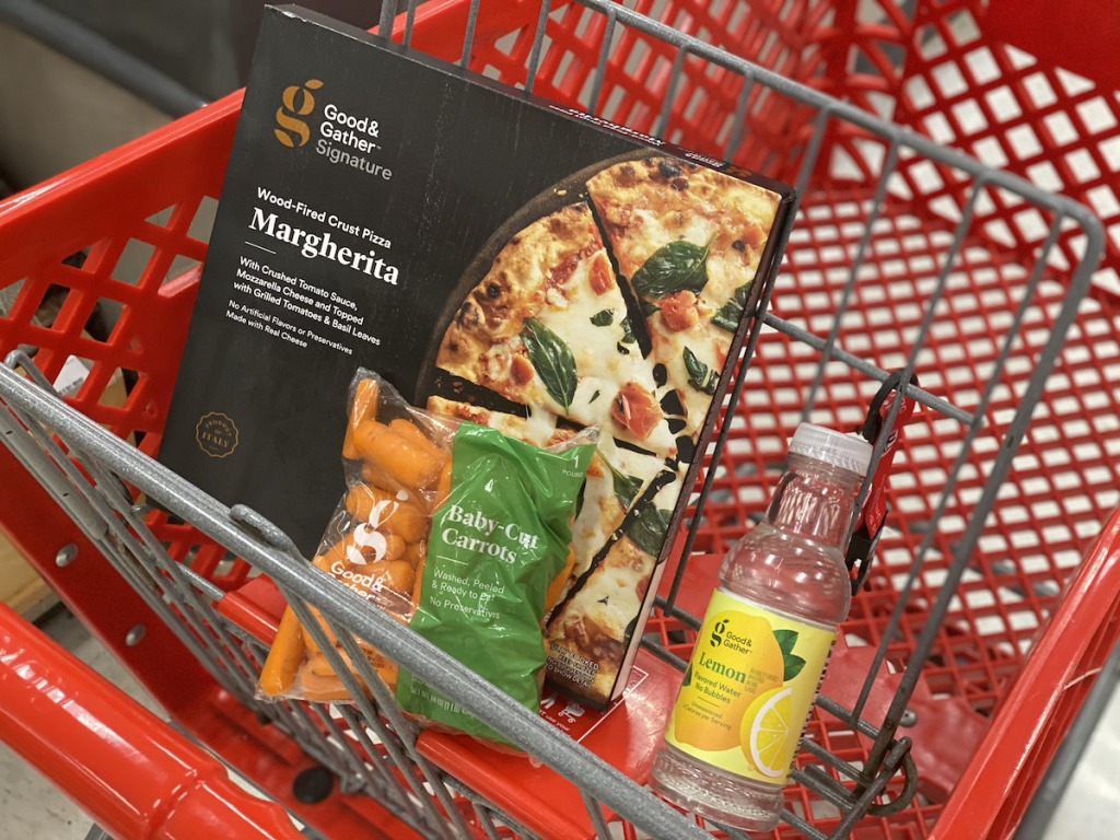 pizza, carrots, and water Good and gather groceries in cart