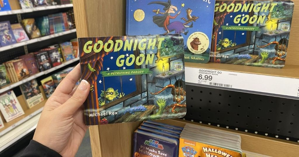 hand holding Goodnight Goon Book in store