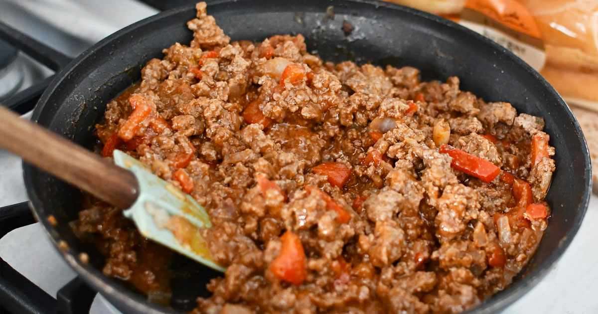 ground beef sloppy joes in frying pan on stove with spatula