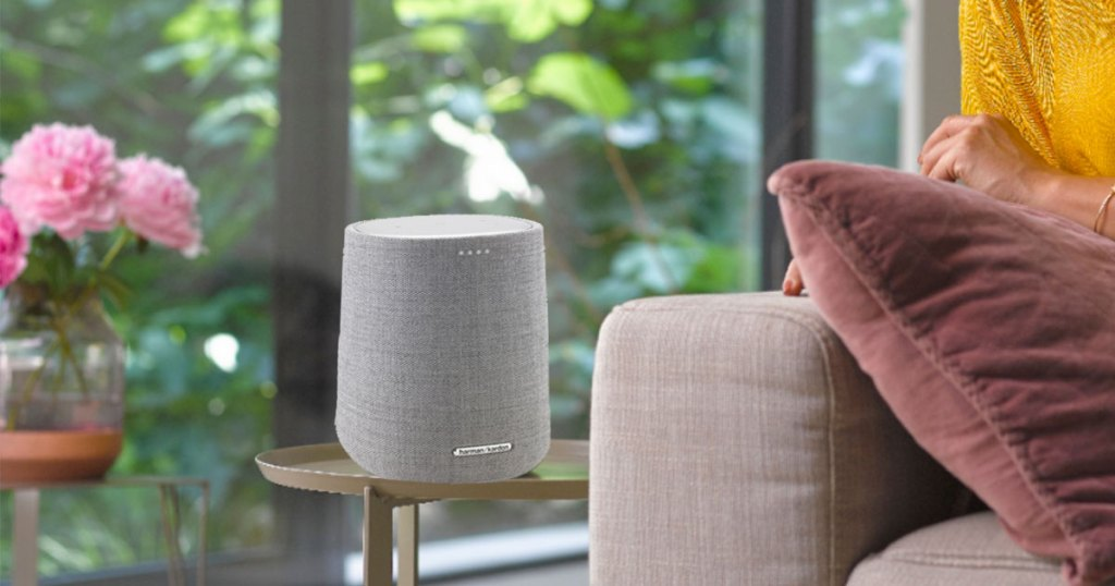 grey smart speaker on side table next to couch