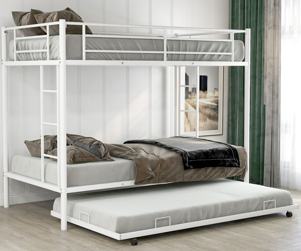 white metal bunk bed with trundle bed pulled out from bottom