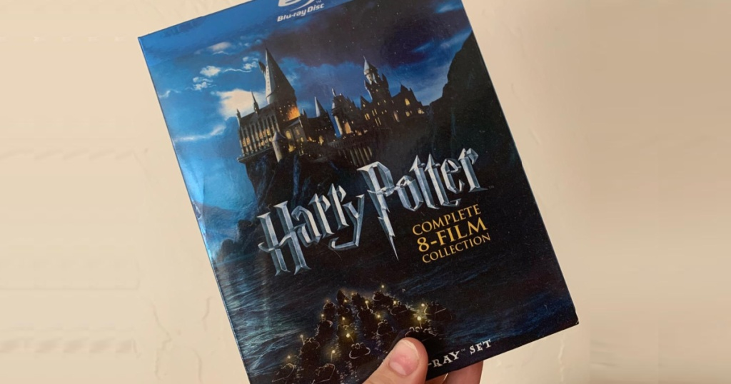 hand holding up Blu-ray movie collection