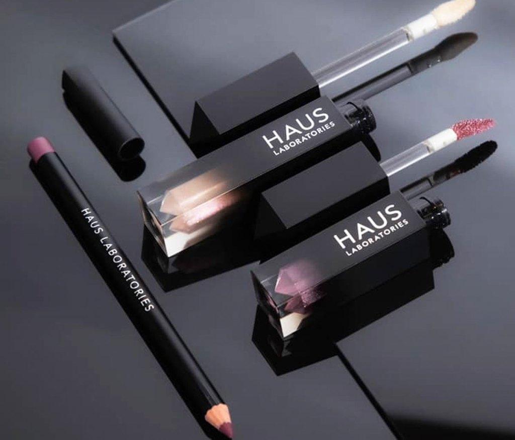 haus laboratories liquid eyeshadow, liquid lipstick, and matching lip liner on a black background