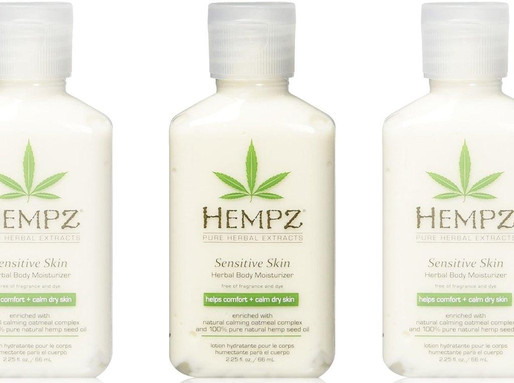 three travel size bottles of Hempz sensitive skin lotion