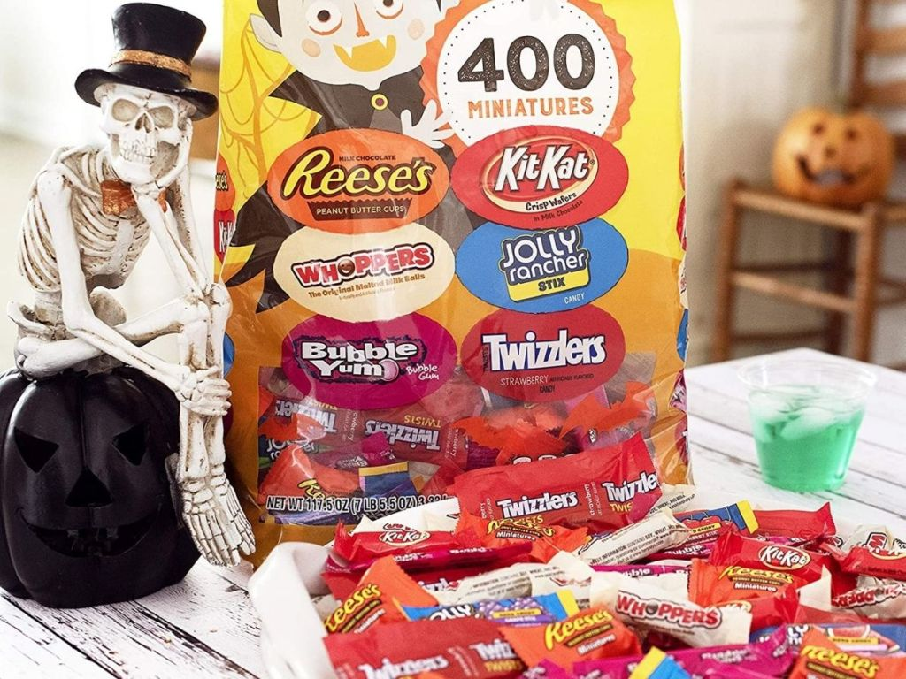 bowl of hersheys halloween candy mix with skeleton man next to it