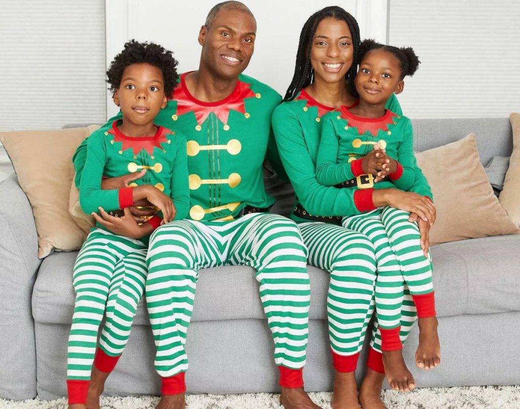 family wearing matching elf print pajama sets