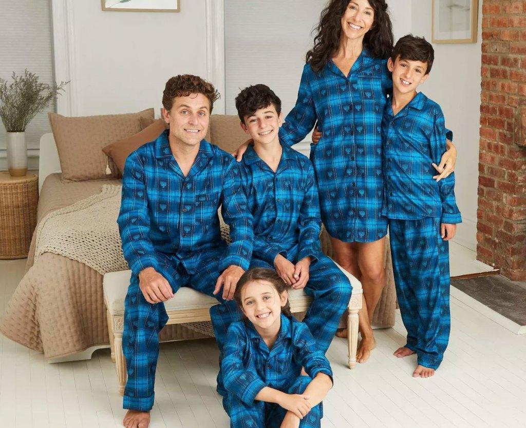 family wearing matching blue Hanukkah printed pajama sets