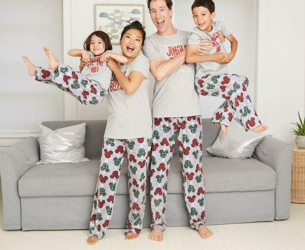 family wearing matching christmas mickey mouse printed pajama pants
