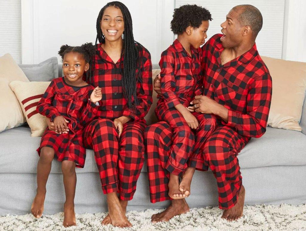 family wearing matching red buffalo check pajamas sets