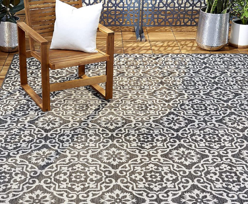 outside patio with black and grey home dynamix rug
