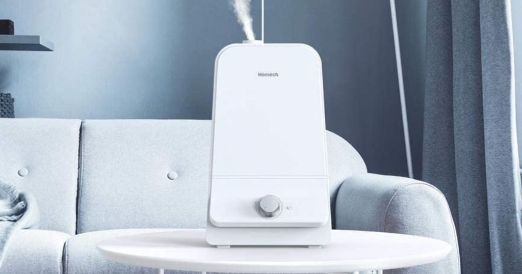 Homech humidifier on white table in front of powder blue couch