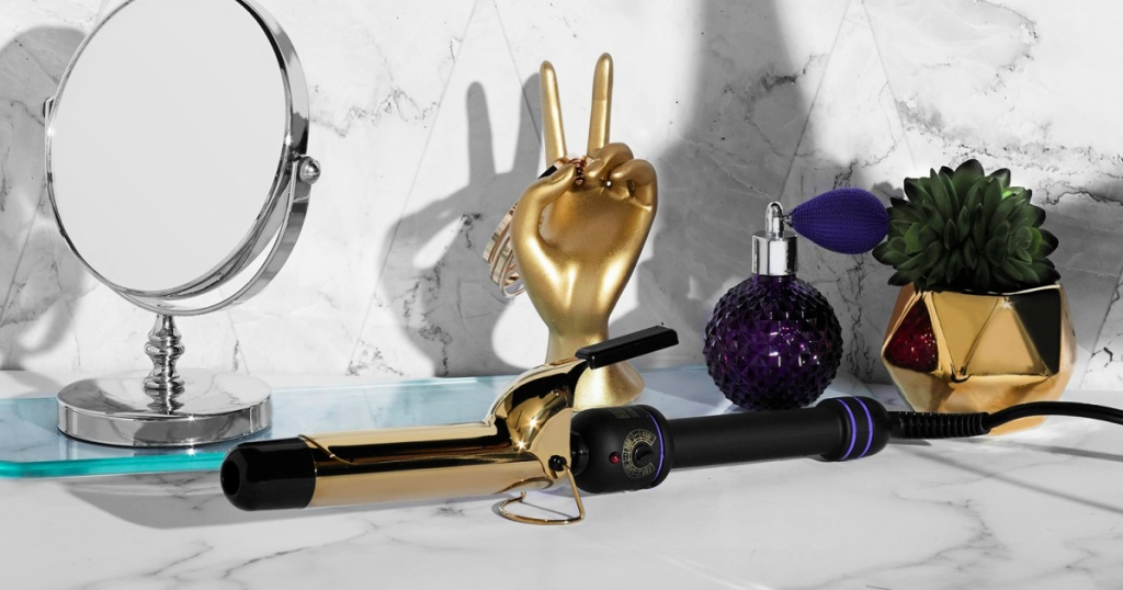 """Hot Tools Signature Series 1"""" Gold Curling Iron/Wand on vanity"""