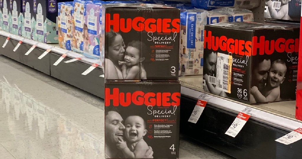 two boxes of diapers on store aisle floor
