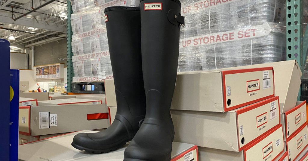 pair of matte black hunter rain boots on display at costco