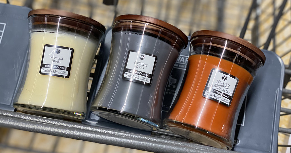three different scented candles in store cart