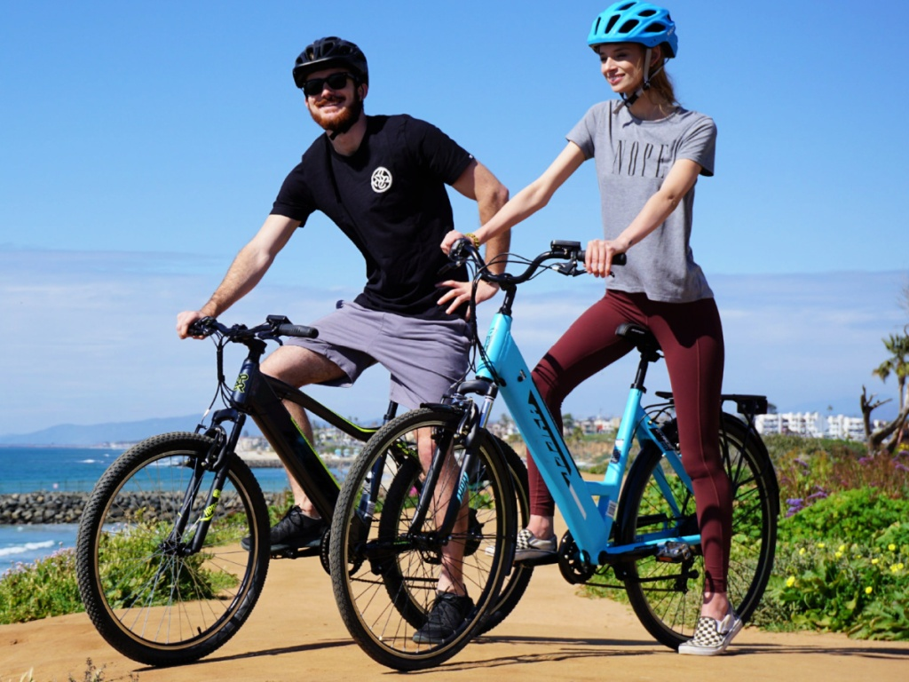 man and woman on Hyper E-ride Electric Mountain Bikes
