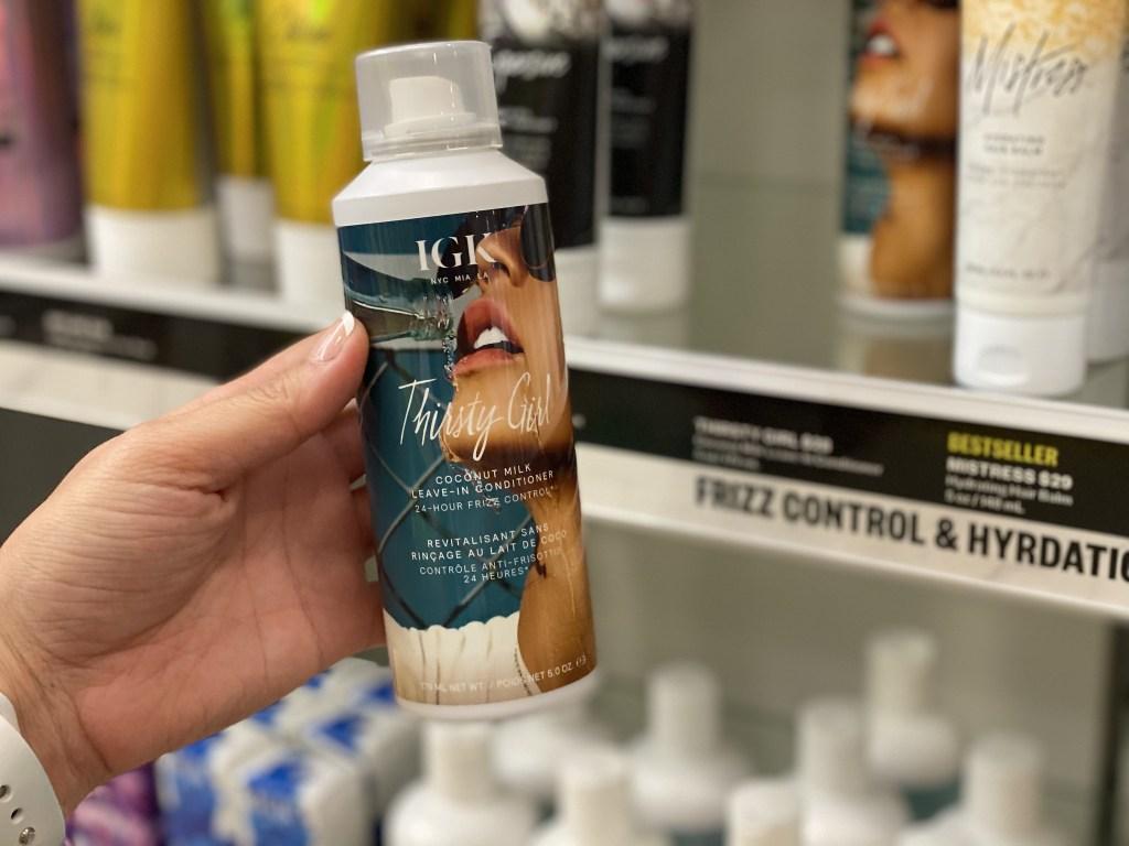 IGK conditioner bottle in hand