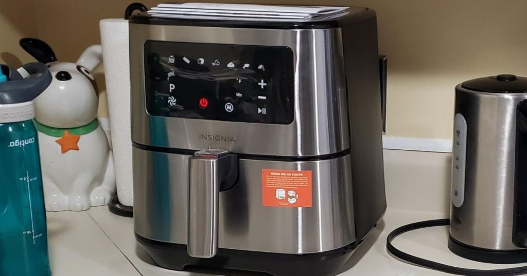 Insignia stainless steel air fryer on a kitchen counter