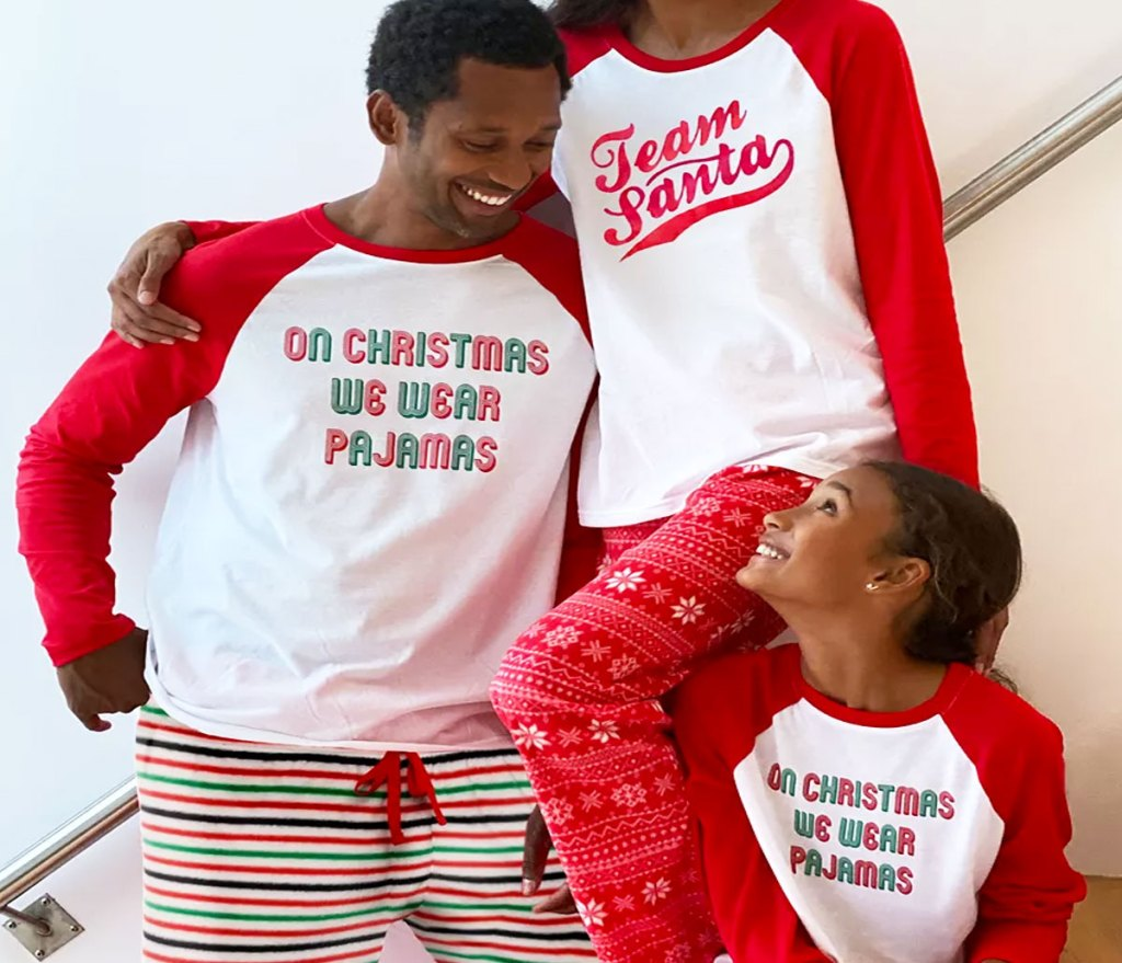 family wearing matching red and white christmas pajamas
