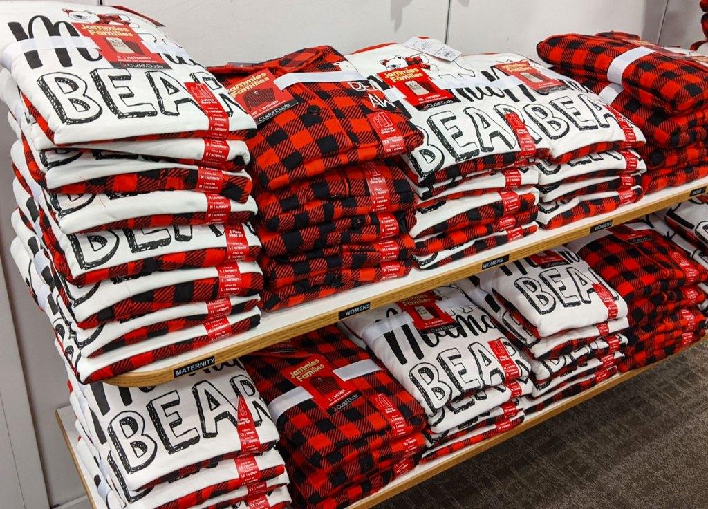 folded bear and buffalo plaid christmas pajamas on kohl's display shelves